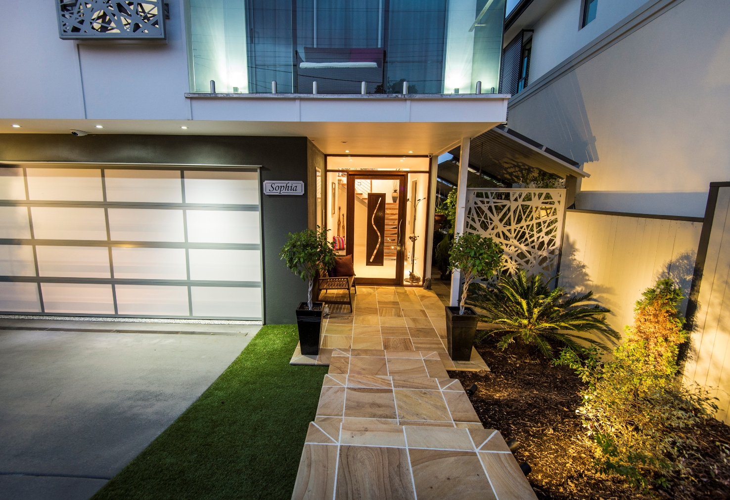 Modern architectural new home brisbane sandstone entry stairs timber pivot door lighting driveway jpg